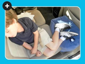 Boy in Car using 1stClassKid+ Travel Pillow